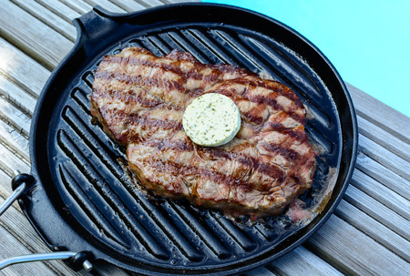 barbecue grilled steak with garlic butter at the  swimming pool party photo