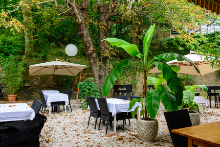 shady: A shady terrace garden in a hotel in Languedoc-Roussillon, France Stock Photo