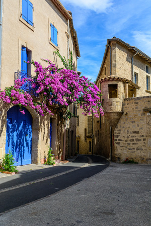 A street corner with flowering bougainvillea in the historical centre of Pezenas, Languedoc, France Stock Photo
