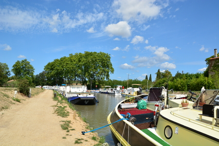 Boats in Canal du Midi in Capestang, Languedoc, France