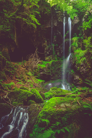 cantal: Waterfall and black cave , Cascade des Razes, Ferrieres-Saint-Mary, Cantal, Auvergne, France
