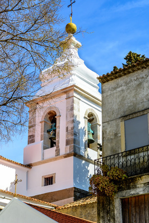 White bell tower in the alfama district in Lisbon, Portugal