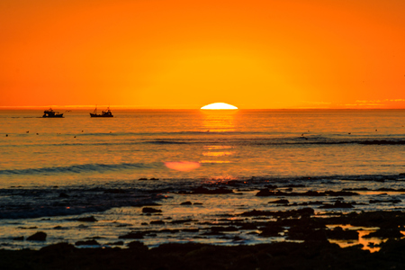 Sunset with fishing boats in La cotiniere, France Stockfoto