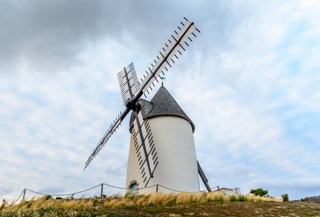 Windmill at the sea in Jard-sur-mer, Vendee, France Stock Photo
