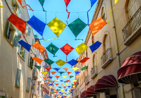 Kites during street festival in Ceret, Roussillon France Stock Photo