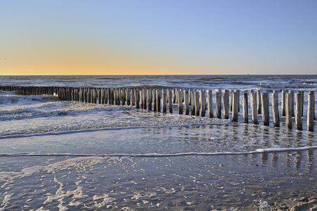 Breakwaters on a winter beach in Vlissingen Holland Stock Photo
