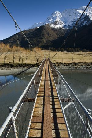 aspiring: Swing Bridge crossing the Matukituki River  Mount Aspiring National Park  South Island, New Zealand  Stock Photo