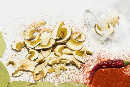 reticulatus: Dried mushrooms Boletus reticulatus,bay leaves,chili,dry red peppers. Stock Photo