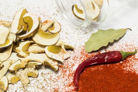 red peppers: Dried mushrooms Boletus reticulatus, chili, bay leaves, dry red peppers.