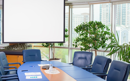 office presentation: empty meeting room with white screen