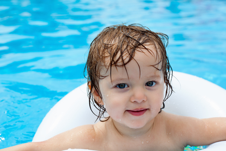 lifeline: Beautiful baby in pool to swimming with a lifeline