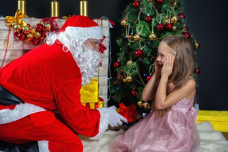 Santa Claus and a girl in a dress. Christmas Scenes. The kids really surprised when I saw Santa