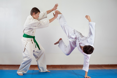 Two boys demonstrate martial arts working together. Fighting position, active lifestyle, practicing fighting techniques