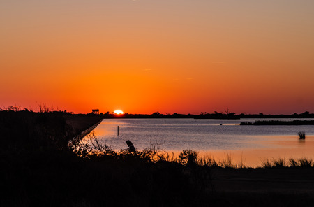 A beautiful orange Sunset in the Outer Banks, Pea Island North Carolina