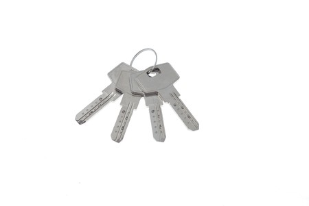 Bunch of new mosern iron keys on white background 3 photo