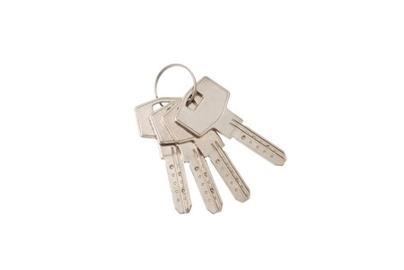 Bunch of new mosern iron keys on white background 4 photo
