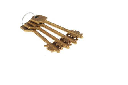 Bunch of old rusty bronze keys on white background 4 photo