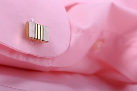 cufflink: Close-up of cufflink on pink shirt 1
