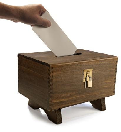 Vote cast into locked ballot box photo