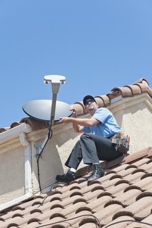 coax: Satellite Installer on Roof