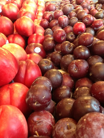 Fresh nectarines and plums at the fruit stand.