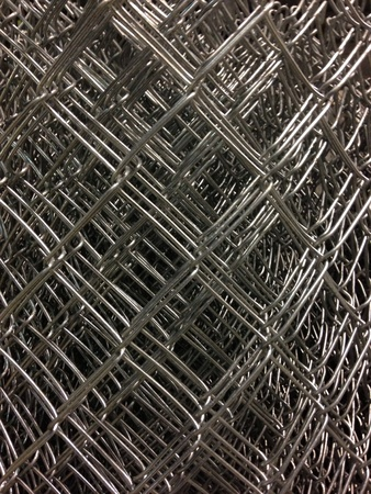 Roll of chain link fence at the hardware store.