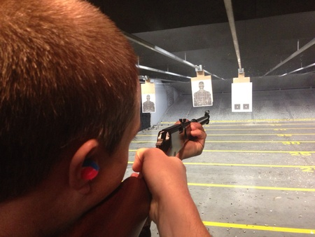 Man aiming at target at the shooting range.