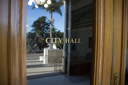 mayoral: A door leading inside of a southern California City Hall building.
