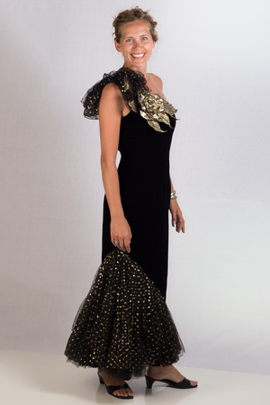 atractive: An atractive young lady posing in an elegant black evening gown.