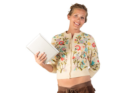 30 something: A pretty young lady holding a tablet device to interact with to communicate or play a game online. She is looking directly at the camera. Waist high shot.