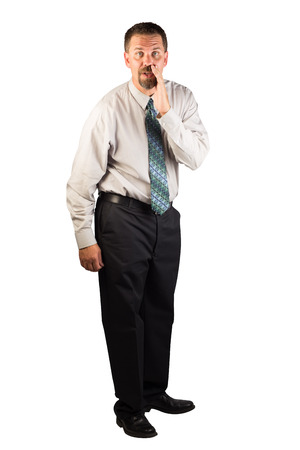 A white collar working standing and telling the viewer a secret or some valuable advise.