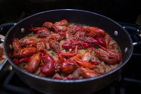 A beautiful skillet full of crawfish jambalaya. This dish was created in the southern United States, in Lousiana.
