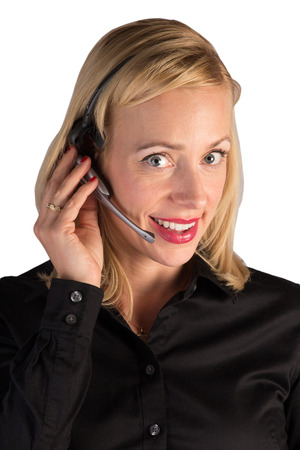 A customer service representative helping a customer on the phone. Stock Photo