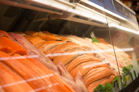 king salmon: Fresh fish stacked for sale at the fish counter in the grocery store. Stock Photo