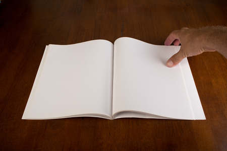 biography: Open blank book or magazine with white paper.  Stock Photo