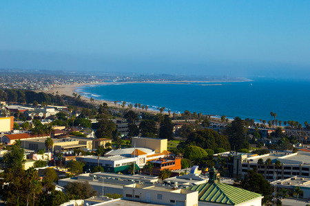 A beautiful view of the Pacific Ocean and the City of Ventura, California  A view of the coastline, beach, waves and buildings fill the scene