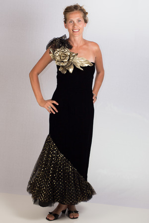 An atractive young lady posing in an elegant black evening gown  Stock Photo
