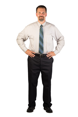 A white collar worker standing facing the viewer with hands firmly on hips
