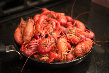 A beautiful red skillet full of crawfish, freshly steamed and ready to eat