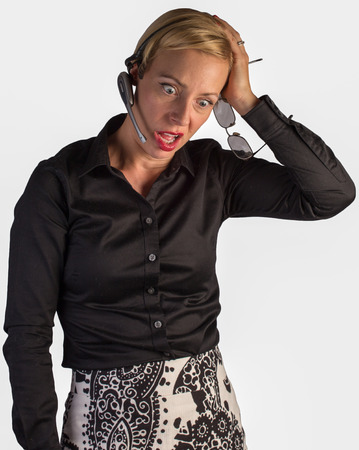 blown away: A customer service representative is on the phone talking to someone and is very upset  Stock Photo