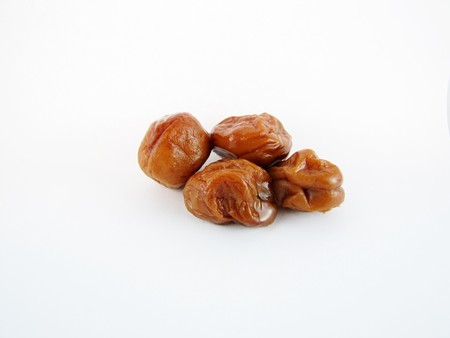 Umeboshi are pickled plums that are popular in Japan. They are extremely sour and salty. They are usually served as side dishes for rice or stuffed inside of rice balls.