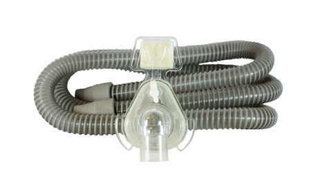 respiratory apparatus: Medical device known as (CPAP) continuous positive airway pressure- mask and hose isolated on white background