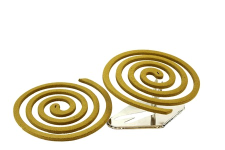 Two Japanese mosquito repellent incense coils isolated on a white background photo