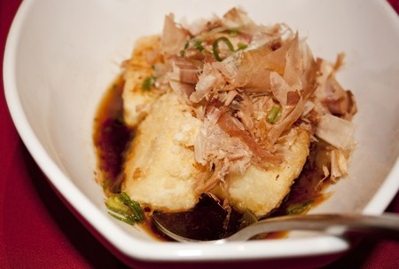 Plate of tofu topped with dried bonito flakes in a white bowl Stock Photo - 7441622