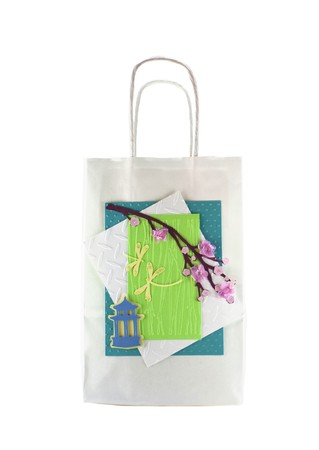 Hand made gift bag isolated on a white background
