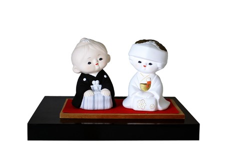 Two dolls of a Japanese bride and groom in wedding outfits