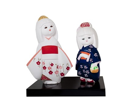 Ceramic dolls of two young japanese girls in kimonos photo