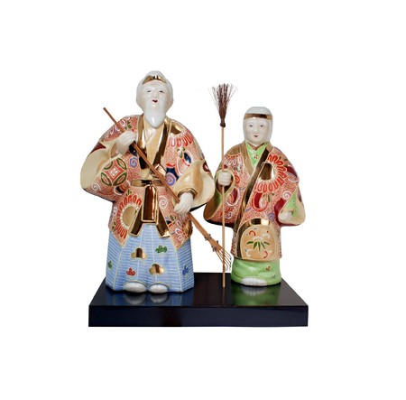 Two dolls of Japanese elderly farmer couple dolls holding rake and broom