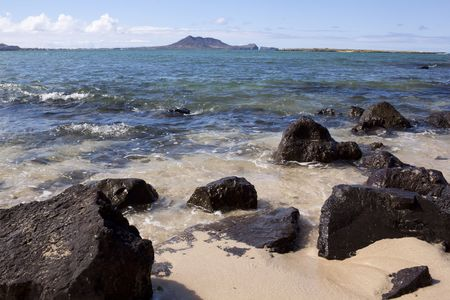 Lava rocks, ocean, mountains landscape in Hawaii Stock Photo - 7742834