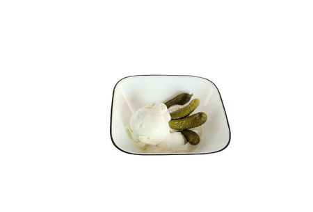 Small pickles and ice cream in a bowl isolated on a white background